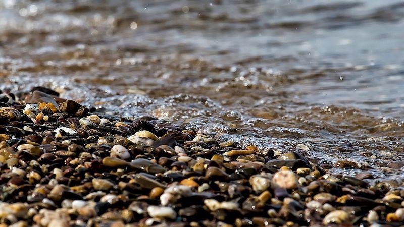 Stones water sand
